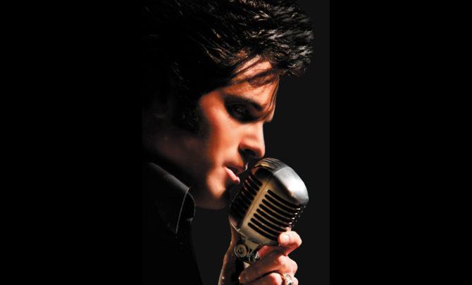 Elvis Prestley at microphone